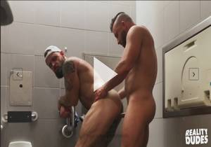 Messy Bareback in Airport Toilet – Tank Joey & Pupcheer