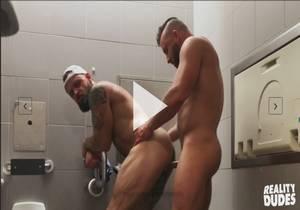 Messy Bareback in Airport Toilet – Tank Joey & Pupcheer